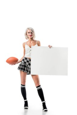 Sexy blond woman in short plaid skirt with rugby ball and empty banner posing isolated on white stock vector