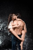back view of sexy young couple with water splash isolated on black