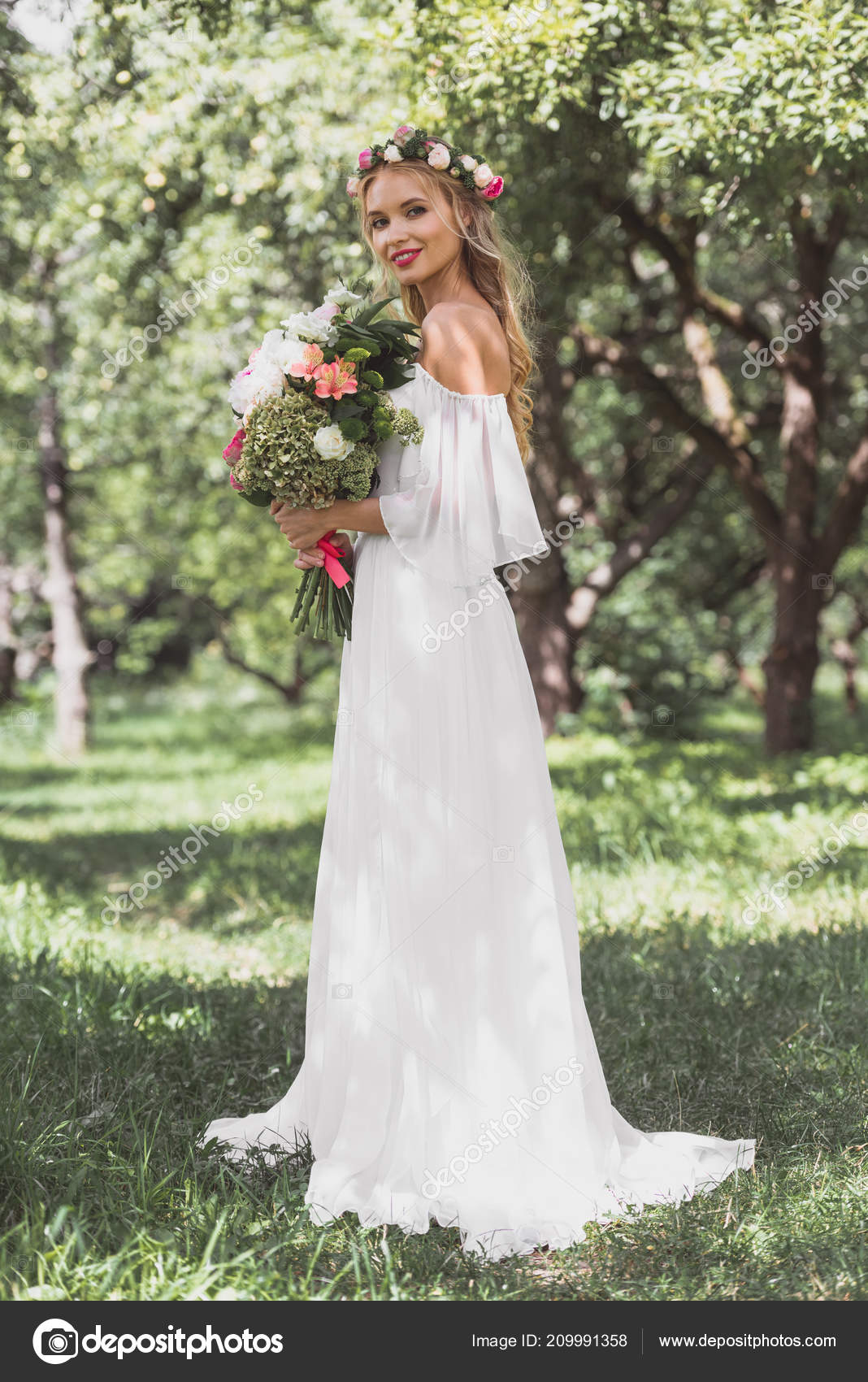 Beautiful Young Bride In Wedding Dress Holding Bouquet Of Flowers And Smiling At Camera Outdoors Photo By VitalikRadko