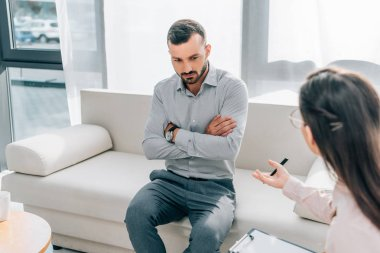psychologist and patient talking in clinic, mental health concept