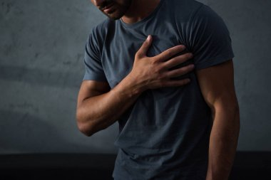 cropped view of man having chest pain and heart attack