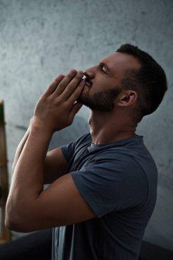 Emotional depressed handsome man at home stock vector