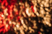 beautiful defocused red and golden bokeh lights, abstract background