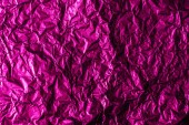 beautiful shiny abstract crumpled violet foil background