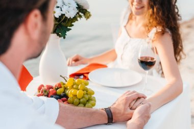 happy couple holding hands after propose in romantic date