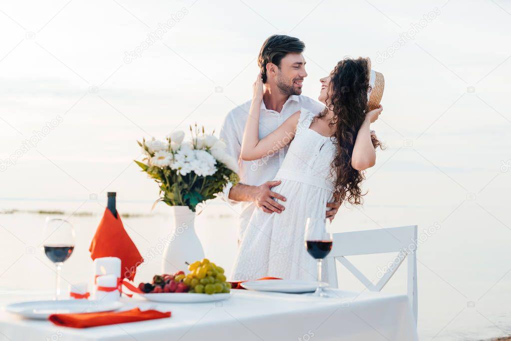 Beautiful happy couple hugging before romantic date on seashore stock vector