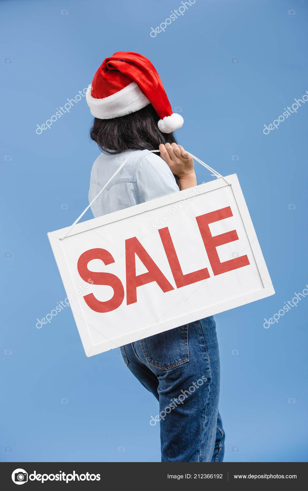 e55075fd145 Back View African American Girl Santa Hat Holding Sale Sign — Stock Photo