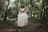 Photo mystic elf in elegant flower dress in forest
