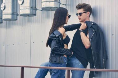 multicultural sexy couple flirting on urban roof