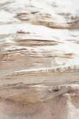 Photo close up of brown dry sand in desert