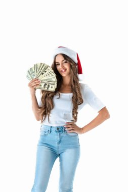 beautiful girl in santa hat holding dollar banknotes, isolated on white
