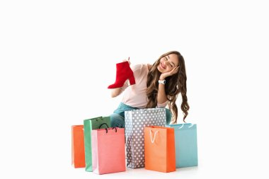 dreamy girl with shopping bags and red shoe, isolated on white