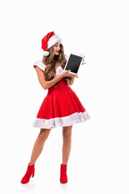 attractive girl in santa costume presenting digital tablet, isolated on white
