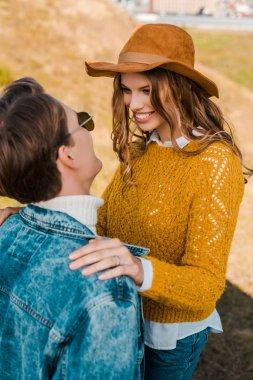 Beautiful girlfriend smiling to boyfriend on rural meadow stock vector