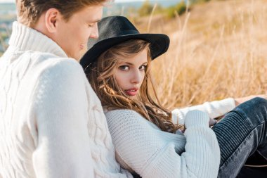 young couple posing on rural meadow