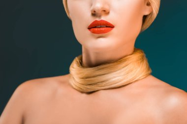 partial view of woman with red lips and blond hair over neck on dark backdrop