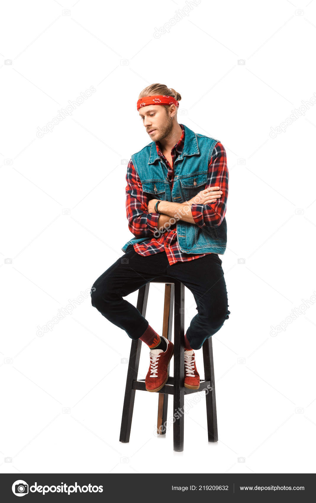 16835316dd Stylish man in denim vest and red checkered shirt sitting on chair with  crossed arms isolated on white — Photo by ...