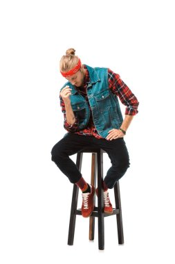 Hipster man in denim vest and red checkered shirt sitting on chair isolated on white stock vector