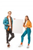 stylish hipster couple pointing at empty banner isolated on white