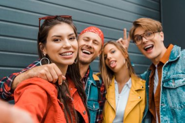 Beautiful stylish hipsters taking selfie together stock vector