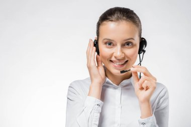 Young smiling call center operator working in headset stock vector
