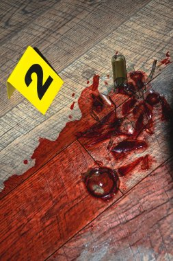 blood at fresh crime scene with evidence marker