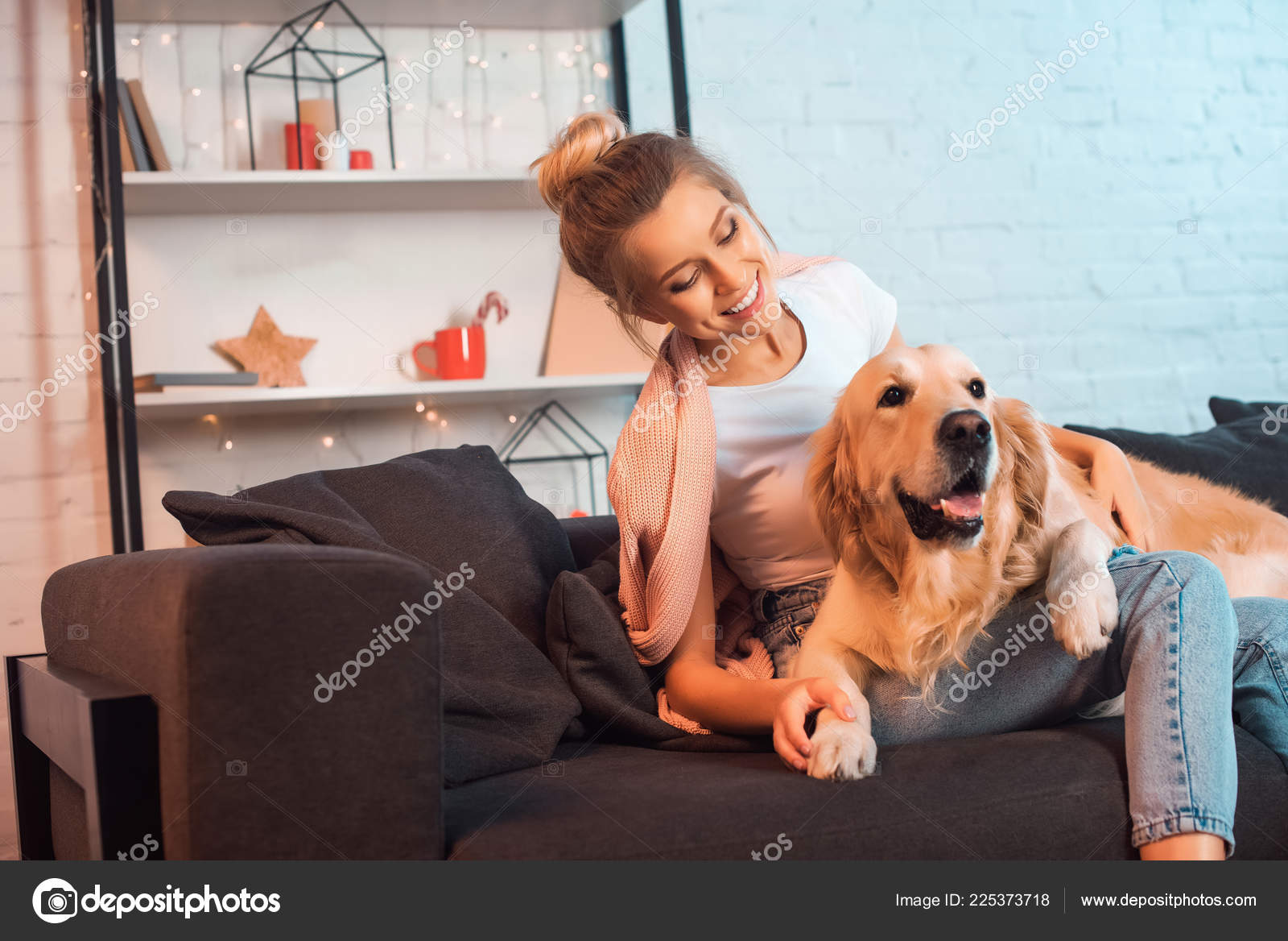 Beautiful Smiling Young Blonde Woman Sitting Couch Hugging Golden
