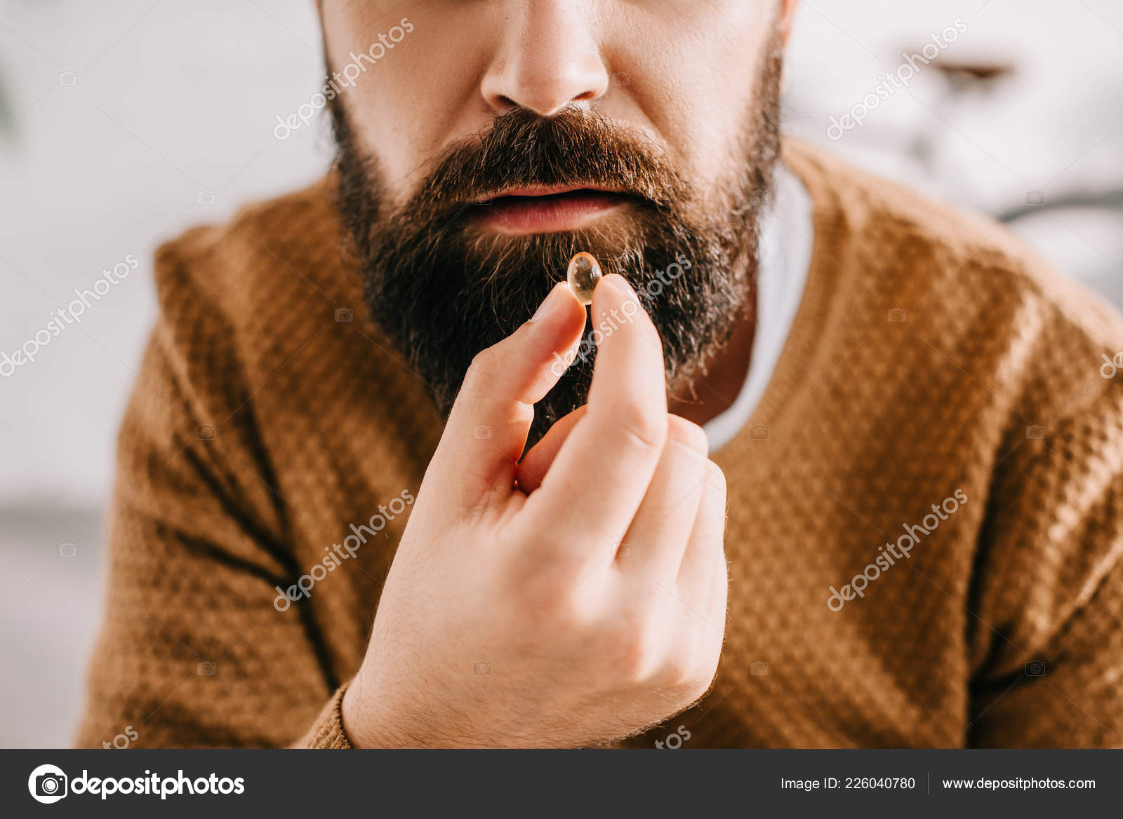 Close Up Of Sick Bearded Man Taking Pill From Illness P O By Vitalikradko