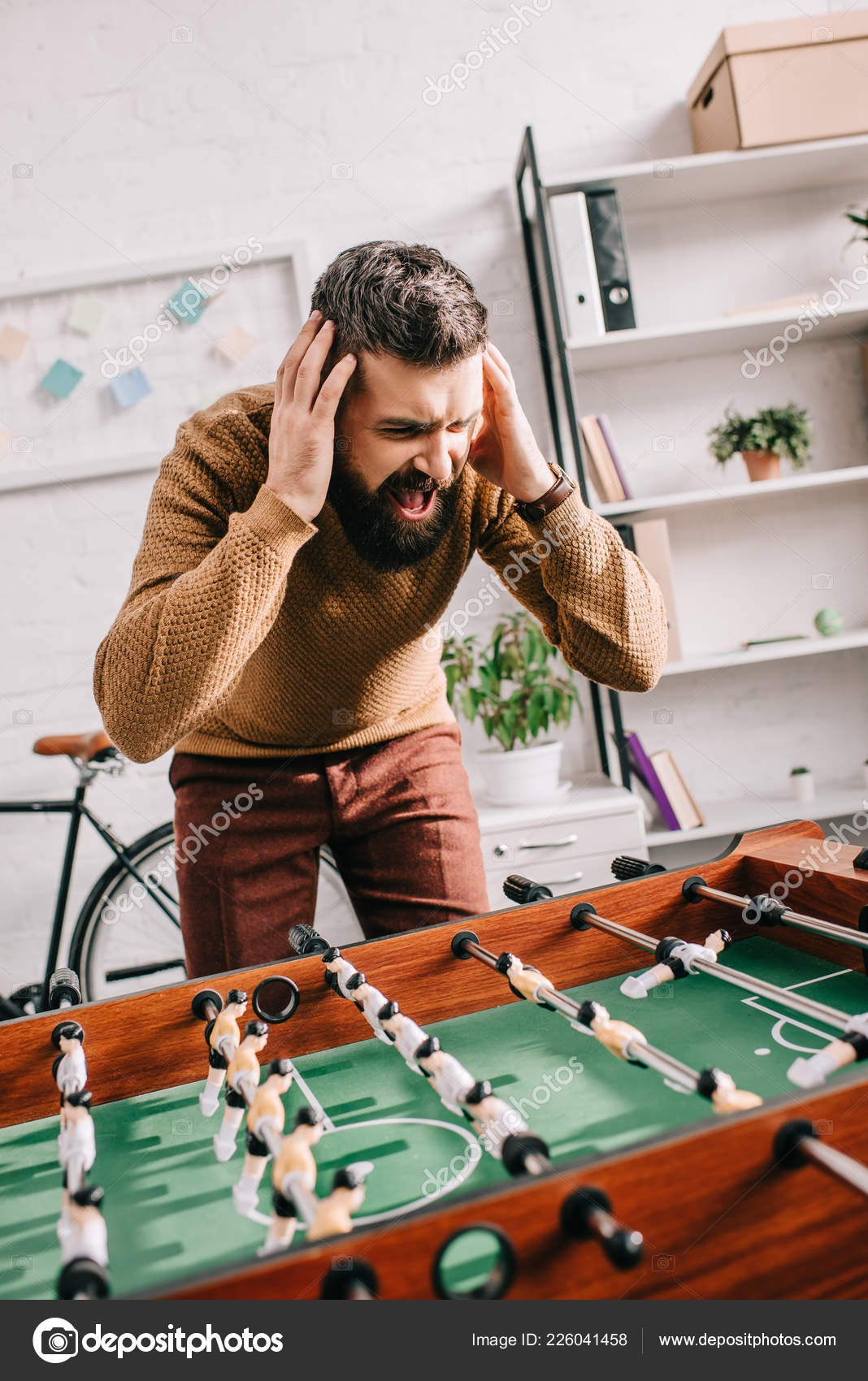 Angry Adult Man Hands Head Yelling Playing Table Football Game