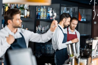 Barmen team in aprons standing at workplace near counter stock vector