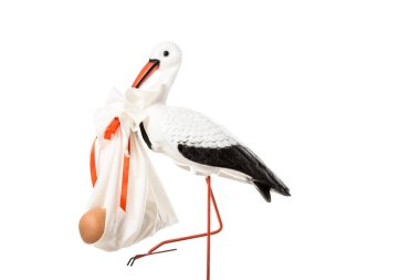decorative stork holding baby nappy with doll isolated on white