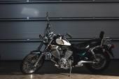 Fotografie side view of motorbike on floor in garage