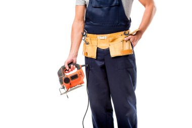 Cropped view of carpenter with tool belt holding electric fret saw isolated on white stock vector