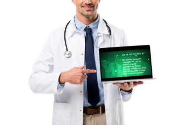 partial view of doctor pointing finger at laptop with health data on screen isolated on white
