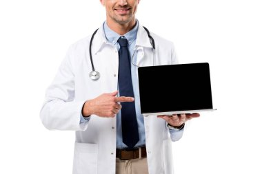 Cropped view of doctor pointing finger at laptop with blank screen isolated on white stock vector