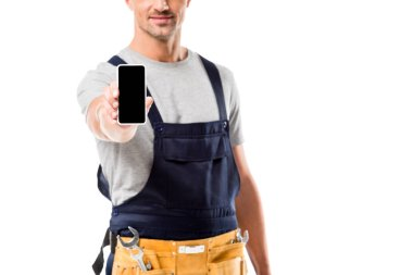 Cropped view of worker holding smartphone with blank screen isolated on white stock vector
