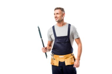 smiling plumber holding pipe wrench isolated on white