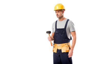Construction worker in tool belt holding hammer isolated on white stock vector