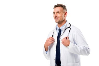 Handsome doctor in white coat with stethoscope looking away isolated on white stock vector