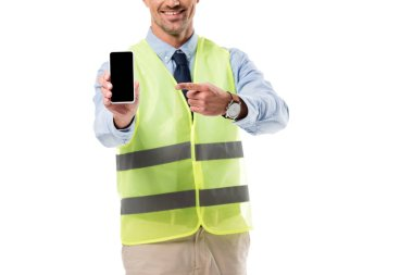 cropped view of engineer pointing with finger at smartphone with blank screen isolated on white