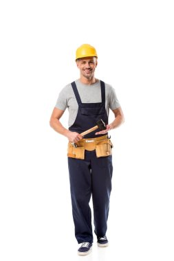 construction worker with tool belt holding hammer isolated on white