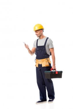 Construction worker in helmet using smartphone isolated on white stock vector