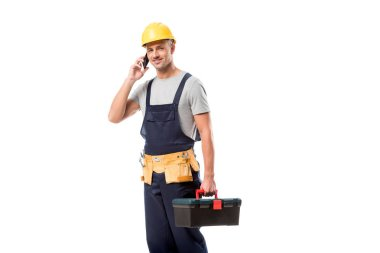 Construction worker in helmet talking on smartphone isolated on white stock vector