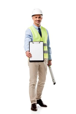 smiling engineer holding clipboard with blank sheet and spirit level isolated on white