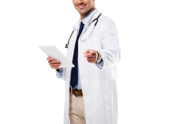 Doctor holding digital tablet and pointing at camera with finger isolated on white stock vector