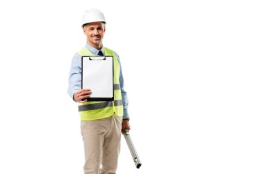 Smiling engineer holding clipboard with blank sheet and spirit level isolated on white stock vector