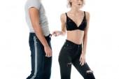 Fotografie verkürzten Blick auf Frau in BH spielerisch berühren Mann Jeans isoliert auf weiss
