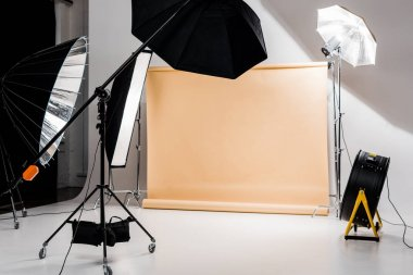 professional photo and lighting equipment in empty photo studio