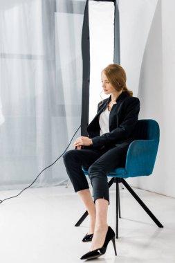 Beautiful young female model posing in professional photo studio stock vector