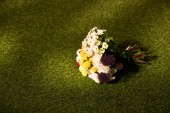 Fotografie bouquet of flowers on green grass with copy space